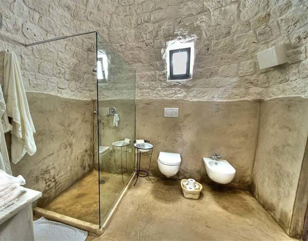 Il bagno in puglia arredarde la zona doccia nel tipici for Idee per arredare un trullo